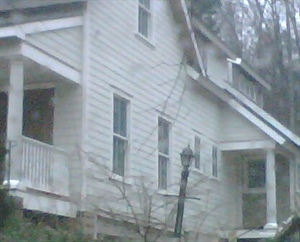 Blurry....but porch railings, columns and more finishes!